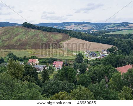Beautiful hilly landscape with houses field and trees in Silesia Poland