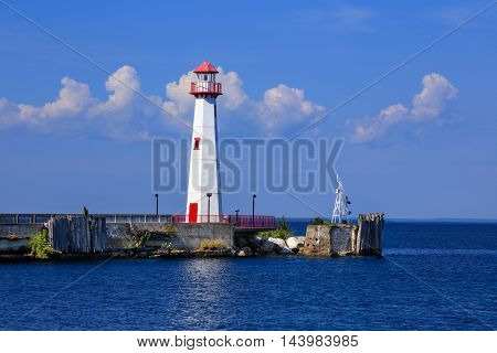The Wawatam Lighthouse or St. Ignace Lighthouse as it looks toward Mackinac Island in the Straits of Mackinac on a lazy Summer afternoon Michigan Upper Peninsula USA