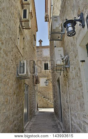 An narrow old historic road in Budva Old Town Montenegro.