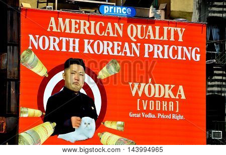 New York City - June 8 2013: Humourous advertising billboard for Wodka (Vodka) featuring North Korean dictator Kim Jun-Un on the exterior of a building in Soho