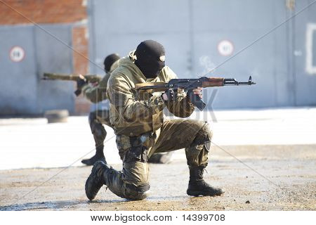 The military man with the weapon