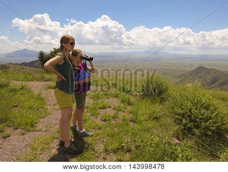 SIERRA VISTA, ARIZONA ,AUGUST 21. Coronado Peak on August 21, 2016, near Sierra Vista, Arizona. A mother and daughter take in the view on top of Coronado Peak in the Huachuca Mountains near Sierra Vista Arizona.