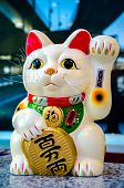 Lucky Cat Maneki Neko or Zhaocai Mao ancient cultural icon from japan and popular in many asian cultures. poster