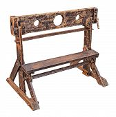 medieval pillory, ancient device used for punishment by public humiliation and physical abuse - old wooden stocks isolated with clipping path poster