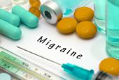 Migraine - diagnosis written on a white piece of paper. Syringe and vaccine with drugs. poster