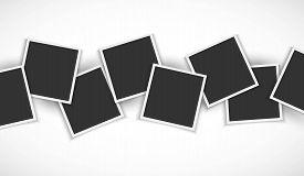 Pile of photo frames on white background