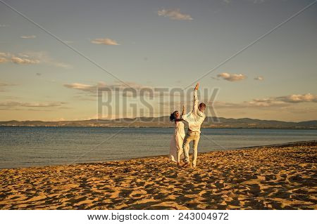 Honeymoon, Just Married Concept. Man And Woman Dancing, Couple Happy On Vacation. Couple In Love Run