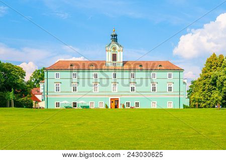 Green Lawn In Front Of Renaissance Chateauin Dacice. Remodeled In The Baroque And Empire Styles. Cze