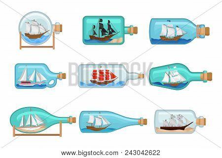 Set Of Glass Bottles With Ships Inside. Sailing Crafts. Miniature Models Of Marine Vessels. Transpar