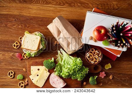 Preparing Ham And Cheese Sandwiches For School Lunchbox On Wooden Background, Close Up. Healthy Eati