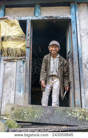 A Smiling Poor Man Stands At The Door Of His Hut On March 30, 2018 In Nepal.
