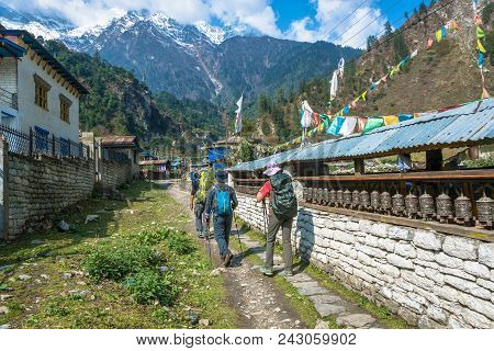 Nepal-march 30, 2018: Group Of Tourists On The Track Around Annapurna March 30, 2018 In Nepal.