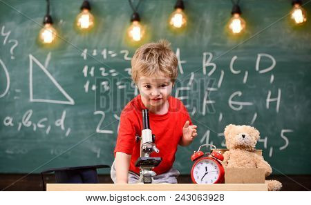 First Former Interested In Studying, Learning, Education. Kid Boy Near Microscope In Classroom, Chal