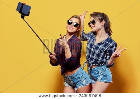 Fashion Portrait Of Two Friends. Modern Lifestyle. Two Stylish Sexy Hipster Girls Best Friends Ready