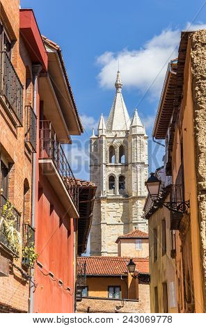 Cathedral Tower Between Colorful Buildings In Leon, Spain