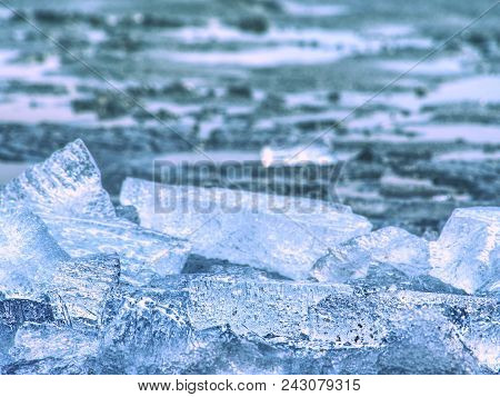 Winter Coastal Under Icy Cover. Icy Andscape With Broken Pieces Of Blue  Ice. Colorful Toned Photo W