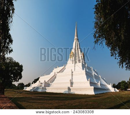 Chedi Phukhao Thong is a large renovated chedi in the Mon style, next to the Buddhist temple of Wat Phu Khao Thong in Ayutthaya historical park, Thailand. poster