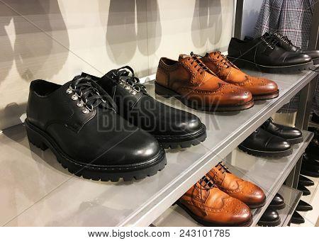 Man shoes on sale in a street market