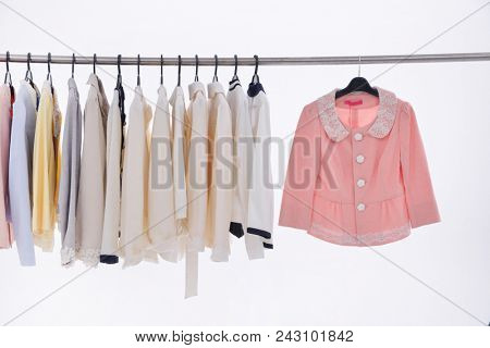 Row of clothes on clothes racks