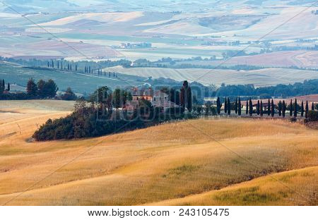 Tuscany, Italy-  June 23, 2017: Beautiful Landscape Of Summer Morning Sunrise Countryside In Italy W