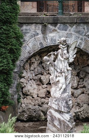 Statue In The Ornamental Garden Near Pelisor Museum, Part Of The Peles Castle, Located In Sinaia, Tr