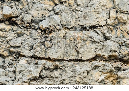 Textured stone background Rubble ballast in natural form in the rock wall. poster