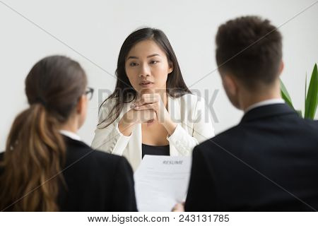 Confident Asian Female Applicant Convincing Hr Managers To Hire Her At Job Interview, Young Skilled