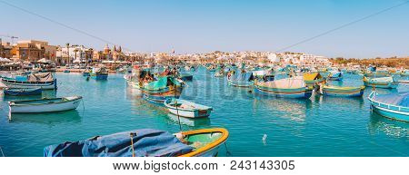 May 02, 2018. Marsaxlokk, Malta. Traditional Eyed Colorful Boats Luzzu In The Harbor Of Mediterranea