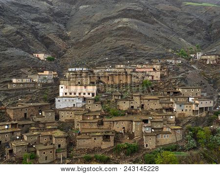 Traditional Berber Village In The High Atlas Mountains: Small Clay Brown Houses With Flat Roofs On T