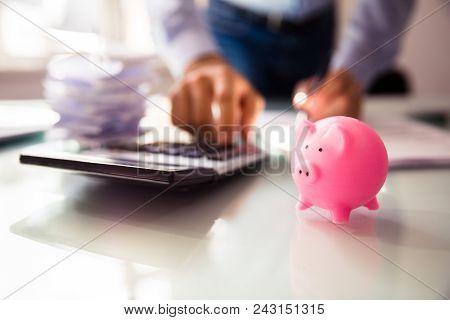 Close-up Of Pink Piggybank On Desk
