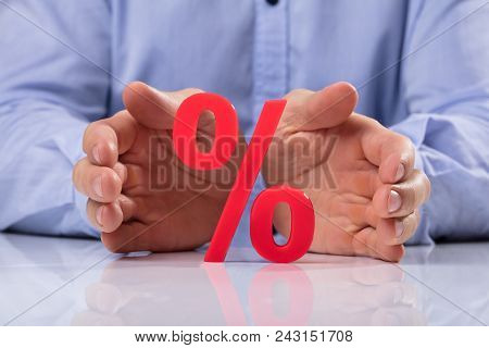 Businessperson Protecting Percentage Sign