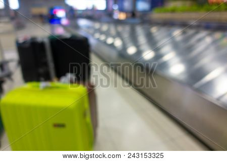 Blurred Defocused Image Of Suitcase, Luggage With Conveyor Belt In The Airport. Blurry Background Of