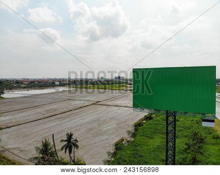Blank Big Billboard For Advertising Against Blue Sky. Big Blank Billboard Sign With Green Color Back
