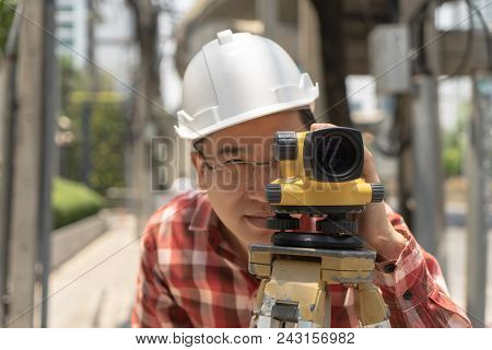 Civil Engineer Land Survey With Tacheometer Equipment Or Theodolite. Worker Checking Construction Si