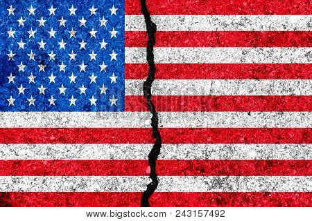 United States Flag Painted On Cracked Wall Background/usa Divided Concept