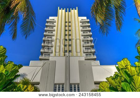 Miami Beach, Florida Art Deco Hotel Building Surrounded By Palm Trees.