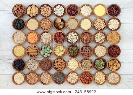 Large macrobiotic health food selection of seeds, nuts, grains, legumes, cereals and whole wheat pasta with super foods high in protein, omega 3, anthocyanins, antioxidants, minerals and vitamins.