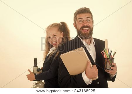 Back To School. Kid And Dad Hold Microscope, Book And Stationery. Girl And Man In Suit And Uniform.