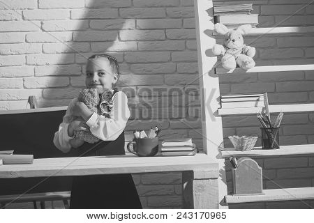 Childhood. Kid In Classroom On White Brick Wall Background. Childhood And Back To School Concept. Sc