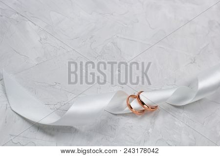 Two Golden Rings And White Satin Ribbon Wedding Decor,wedding Invitation Background Or Golden Rings