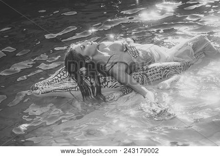 Inflatable Crocodile And Woman In Pool. Inflatable Mattress With Woman In Water