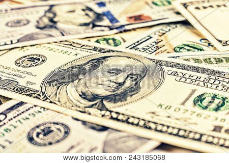 Dollars Usa. Background Of 100 Dollar Bills. A Lot Of Dollar Bills Scattered On A White Background.