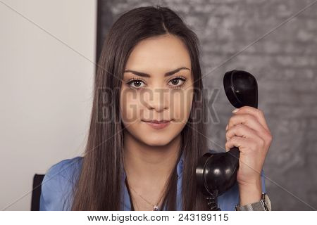 Business Woman Is Negotiating On The Phone