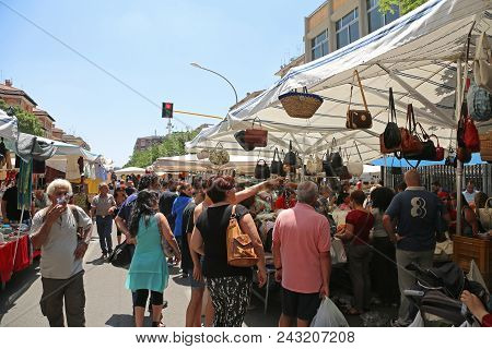 Rome, Italy - June 29, 2014: People Browsing For Cheap Bags And Clothing At Porta Portese Sunday Fle