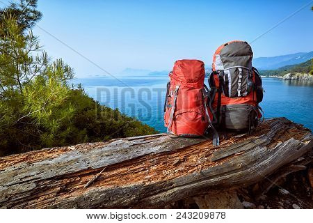 Two Backpacks In The Camp On A Hike Along The Coast In The Summer.