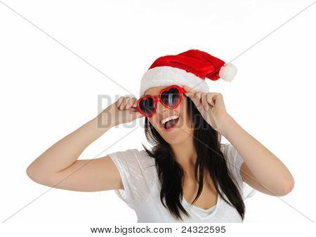 Funny Sexy Santa Clouse Woman In Casual Clothes, Hat And Red Heart Shaped Glasses. Isolated