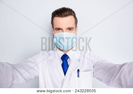 Self Portrait Of Creative Funny Dentist In White Lab Coat, Blue, Tie, Protective Face Mask Shooting