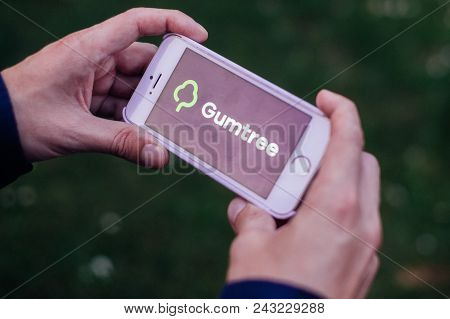 Berlin, Germany - May 30, 2018: Closeup Of Hands Holding Iphone Screen With Gumtree Logo And Icon