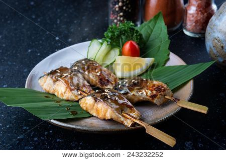 Skewer grilled saba fish with salt set and serve in Japanese style saba shio yaki. poster