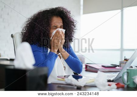 Sick African American Girl Working From Home Office. Ill Young Black Woman With Cold, Sitting At Des